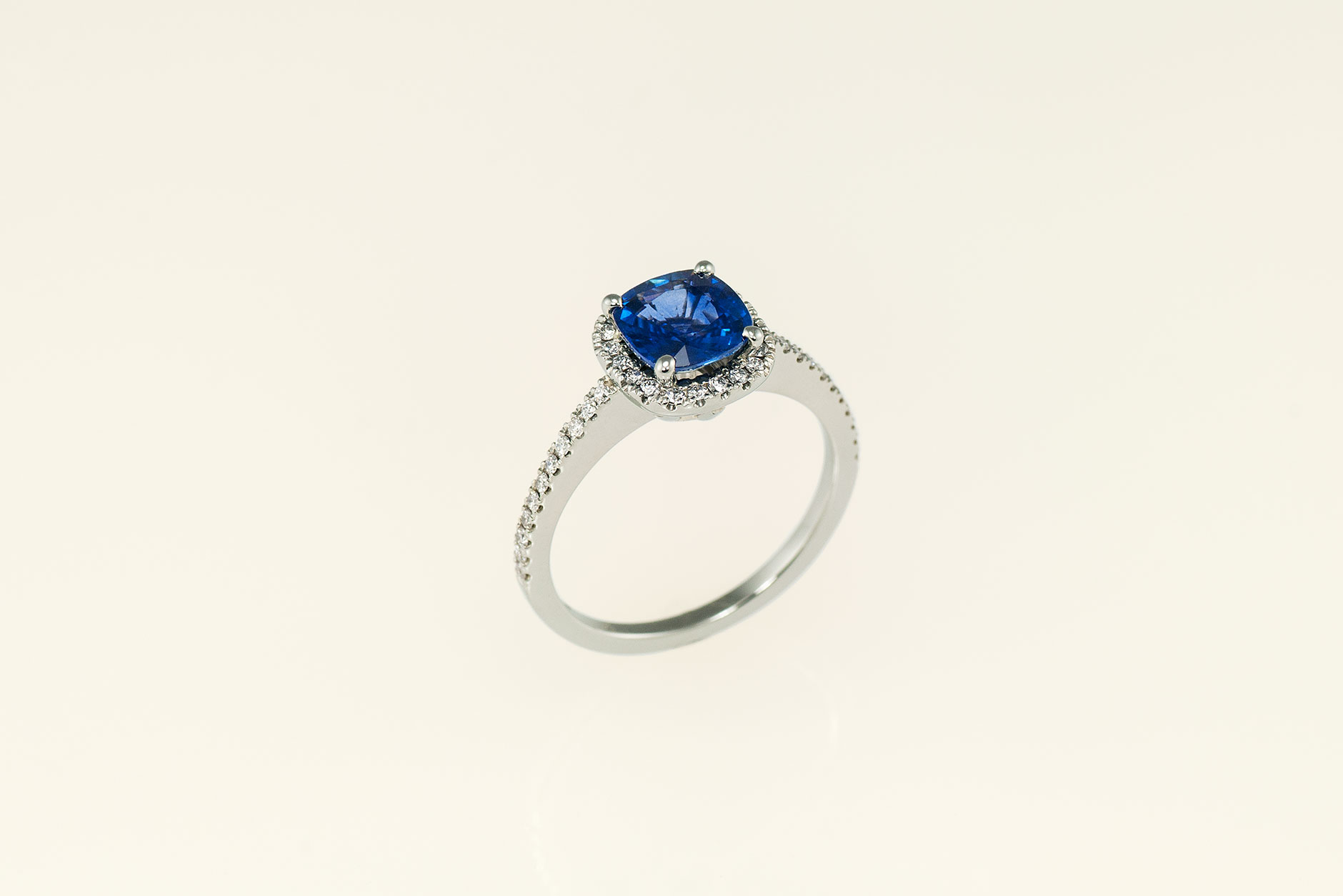 19k White Gold Cushion Cut Blue Sapphire Halo Engagement Ring standing - NEWA Goldsmith